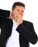 Middle-aged man yawning Royalty Free Stock Images