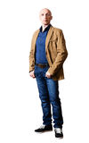 Middle-aged man in a yellow jacket and blue jeans Royalty Free Stock Image