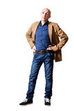 Middle aged man in a yellow jacket and blue jeans Royalty Free Stock Image