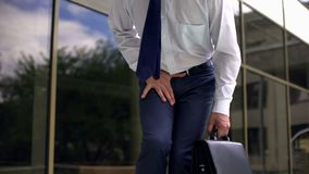 Middle-aged manager feeling strong pain, prostatitis, male genital disease. Stock photo stock photography