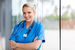 Middle aged medical nurse. Beautiful middle aged medical nurse in hospital Stock Photos