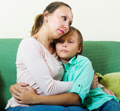 Middle-aged mother consoling sad teenager Stock Image