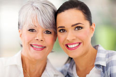 Middle aged mother daughter. Portrait of middle aged mother and young daughter at home Stock Photography