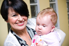 Middle aged mum with baby Royalty Free Stock Images