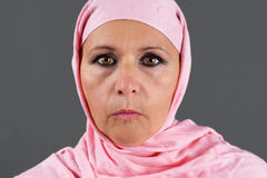 Middle aged muslim in pink scarf Royalty Free Stock Image