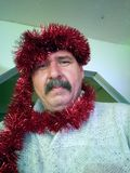 Man wearing red garland boa. Middle aged mustache men wearing red garland boa royalty free stock photography