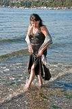 Middle Age Woman Dress in Water Royalty Free Stock Images
