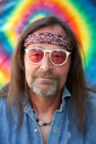 Middle-aged nonconformist man wearing sunglasses royalty free stock image