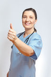 Middle aged nurse thumbs up Royalty Free Stock Image