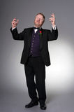 Middle aged opera singer performing. Bearded mature opera singer, sings passionately Royalty Free Stock Photo