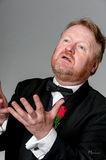 Middle aged opera singer performing. Bearded mature opera singer, sings passionately Royalty Free Stock Image