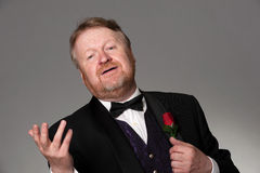 Middle aged opera singer performing. Bearded mature opera singer, sings romantically Stock Images