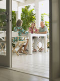 Middle Aged People At Verandah Table Stock Photography