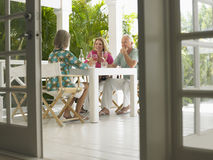 Middle Aged People At Verandah Table Royalty Free Stock Image