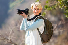 Middle aged photographer Stock Images