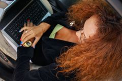 Middle-aged redhead businesswoman Stock Photo