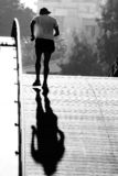 Middle aged runner crossing bridge Royalty Free Stock Image