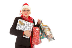 Middle aged santa woman, gifts Royalty Free Stock Photography