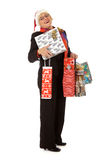 Middle aged santa woman, many gifts Stock Photography