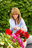 Middle aged small florist owner Royalty Free Stock Photos
