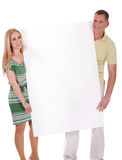 Middle aged smiling couple holding Royalty Free Stock Photography