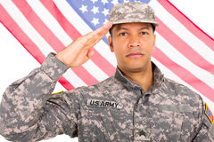 Middle aged soldier saluting Stock Photo