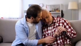 Free Middle-aged Son Comforting Retiree Terminally Ill Father, Suffering Pain, Care Royalty Free Stock Photography - 154955687