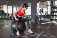 Modern adult woman training biceps stock photos