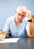 Middle Aged Student - Frustrated. Middle aged man goes back to college and experiences frustration with the learning process Royalty Free Stock Images