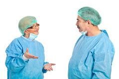 Middle aged surgeons having conversation Stock Images