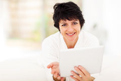 Middle aged tablet Stock Photography