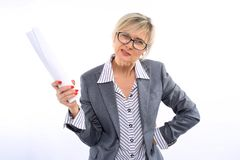 A middle-aged teacher, 40 years old, in a white striped shirt, gray suit and glasses, with a red manicure, holding white paper. On a white background stock photos