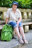 Middle-aged tourist with a backpack Royalty Free Stock Photography