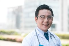 Middle-aged Vietnamese doctor Stock Photo