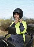 Middle-aged Woman Adjusting Motorbike Helmet Royalty Free Stock Photos