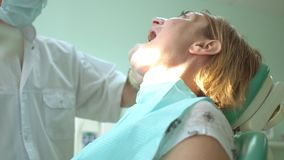 Middle aged woman at admission from a dentist examining her teeth. Dentistry stock video