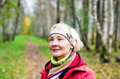 A middle-aged woman in autumn Park Stock Image