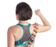 Middle-aged woman back massage device for massaging. Royalty Free Stock Photography