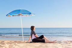 Middle-aged woman on the beach carefree and relaxing. Un Royalty Free Stock Photography