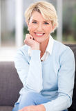 Middle aged woman. Beautiful middle aged woman sitting at home Stock Photos