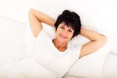 Middle aged woman bed Royalty Free Stock Image