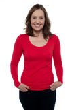 Middle aged woman in bright red top royalty free stock photography