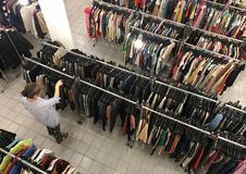 Middle aged woman buys clothes at second hand store Stock Photos