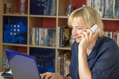 The middle aged woman is calling a mobile phone Stock Images