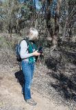Middle-aged Woman With Camera on Hike. Royalty Free Stock Image