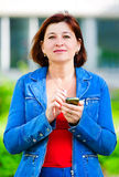 Middle-aged woman with cellphone Stock Photos