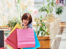 Middle aged Woman With colored Shopping Bags Royalty Free Stock Photos