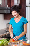 Middle aged woman cooking Royalty Free Stock Photo