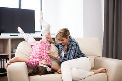 Middle aged woman on the couch with her teenage daughter. Middle aged women on the couch with her teenage daughter in the living room Stock Images