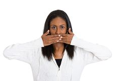 Middle aged woman covering closed mouth Royalty Free Stock Photos